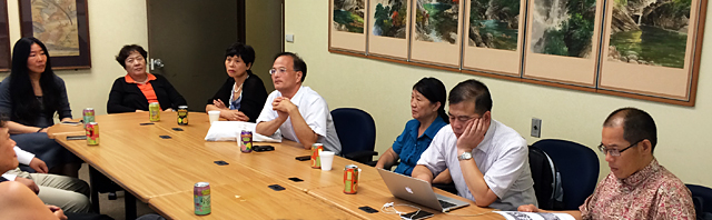 Officials from China, who direct key research offices about Zhou Enlai, meet with officials from the University of Hawaii, Honolulu.